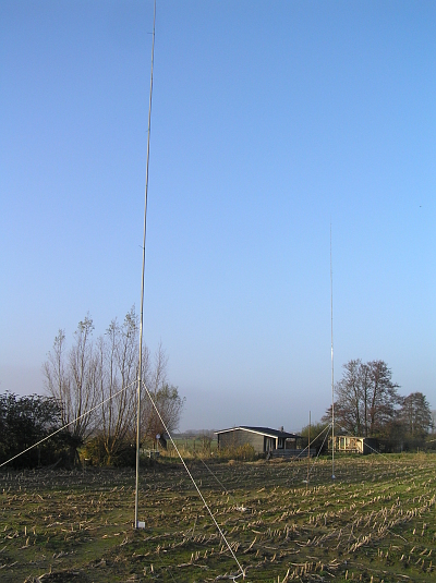 These are two verticals, based on fibreglass masts. The front one is a 1/4 wave antenna for 40m with 16 radials. The rear one is a 5/8 for 20m with 32 radials.